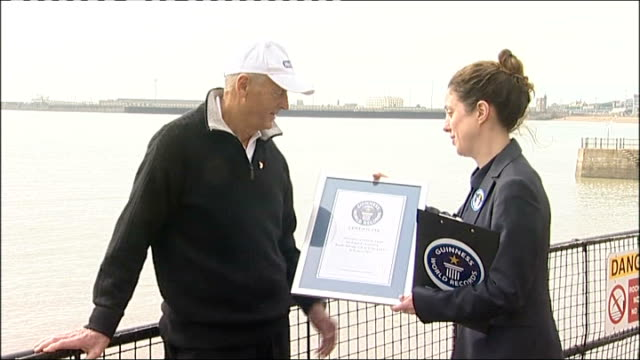 Seventyyearold grandfather breaks world record as oldest person to swim English Channel EXT Presentation to Allsopp of framed certificate Allsopp...