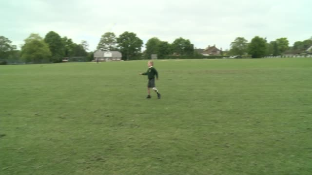 sevenyearold has prosthetic leg painted with charlton athletic colours england london ext various of charlie hewson playing football with prosthetic... - prosthetic equipment stock videos & royalty-free footage