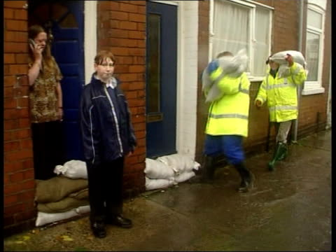 Flooding ITN ENGLAND Yorkshire York Pub partially submerged by floodwater GVs flooded street of older buildings in city centre John Simmonds...