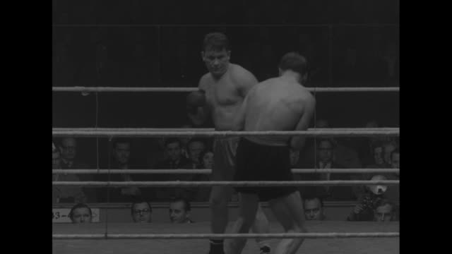 several action shots of fight between german heavyweight heinz neuhaus and austrian heavyweight kurt schiegl, interspersed with two shots of people... - traditionally austrian stock videos & royalty-free footage