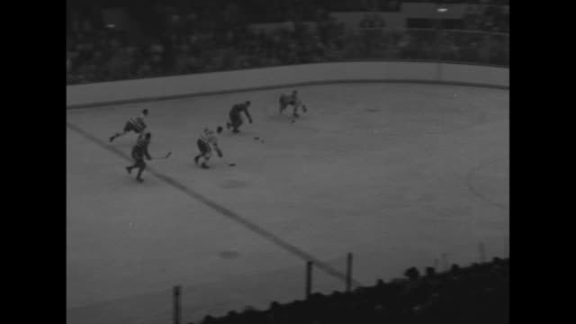 Several action shots of hockey game between Detroit Red Wings and Montreal Canadiens in Joe Louis Arena in Detroit interspersed with shots of...