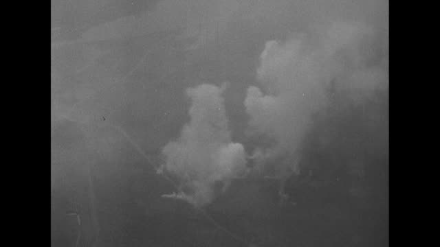 Several aerial shots of smoke rising from exploding shells fired by US artillery / Note exact month/day not known