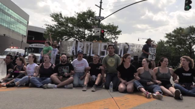 """several anti-ice activist groups shut down west side highway to protest ice immigrant arrests and detentions with signs """"close the camps"""" """"abolish... - campaigner stock videos & royalty-free footage"""
