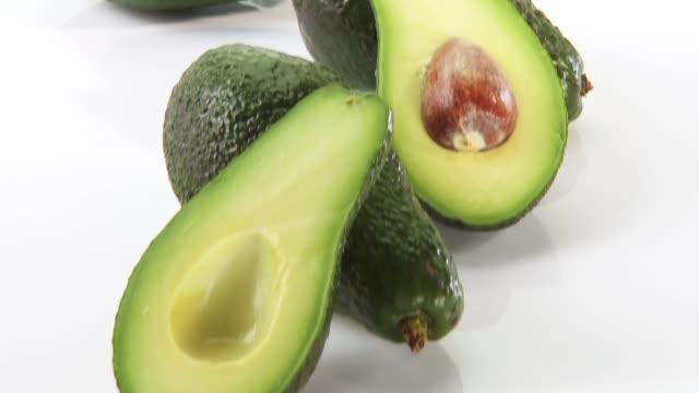 vídeos y material grabado en eventos de stock de several avocados - aguacate