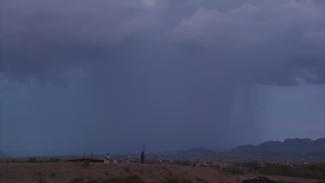 several bright lightning bolts strike hill near tucson, arizona, usa. - lightning strike stock videos and b-roll footage