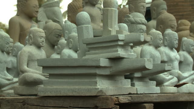 several buddhist sculptures in san tok, cambodia - effigy stock videos & royalty-free footage