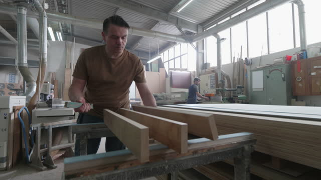 several carpenters working in an open bright carpentry shop - leipzig saxony stock videos & royalty-free footage