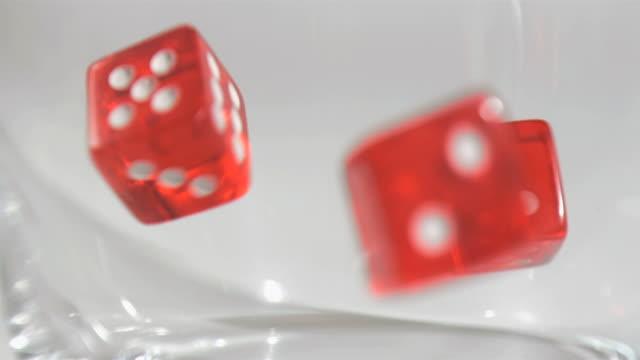 several dice in super slow motion falling - fünf gegenstände stock-videos und b-roll-filmmaterial