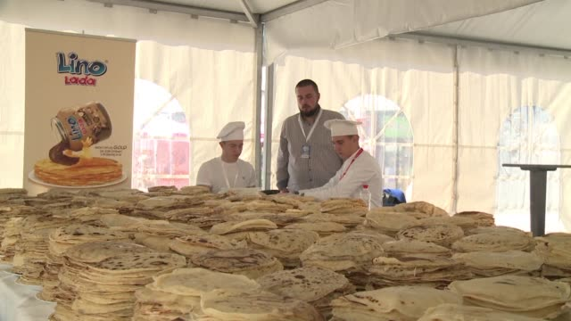 several dozen cooks and apprentices from the former yugoslavia prepared more than 14000 pancakes in eight hours on friday in sarajevo to beat the... - french food stock videos and b-roll footage