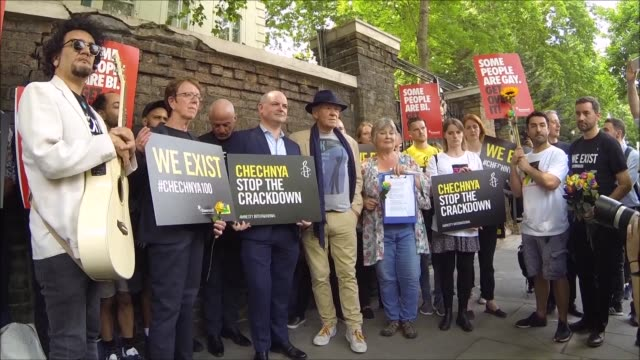 Several dozen people gather in front of the Russian embassy in London to protest the reported crackdown on gay men in the North Caucasus region of...