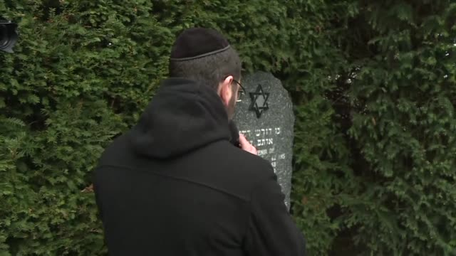 several elected officials and members of the jewish community gather in quatzenheim for a ceremony following the desecration of 96 graves in the... - cemetery stock videos & royalty-free footage