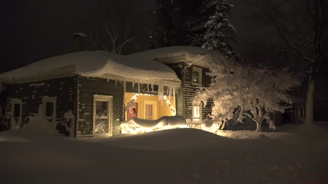 Several feet of snow covers a house in Lacona New York in the wake of a record breaking lake effect snow storm Massive icicles can be seen hanging...