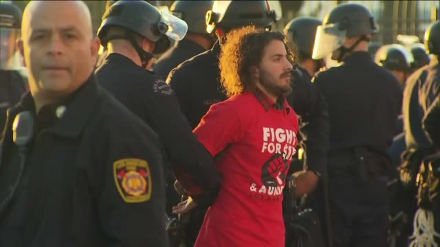 KTLA Several 'Fight for 15' protesters were taken into custody after members of the group sat and blocked an intersection in downtown Los Angeles