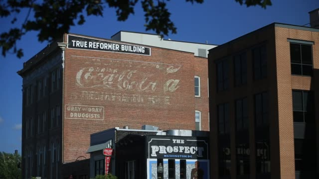 several generic shots of u street in washington dc us on thursday aug 11 2016 shots shot of saxophone sign on side of building cu shots of saxophone... - woodwind instrument stock videos and b-roll footage