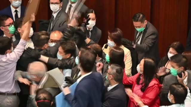 several hong kong prodemocracy lawmakers were ejected from a house committee meeting at the city's legislature on friday following a scuffle with... - politician stock videos & royalty-free footage