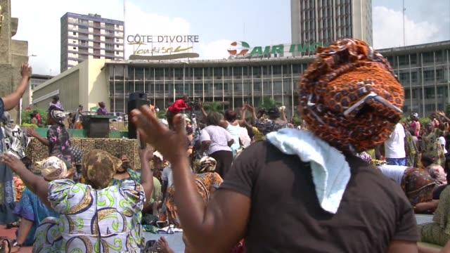several hundred christians gathered in central abidjan on monday to pray for peace in ivory coast and show their support for selfdeclared president... - côte d'ivoire stock videos & royalty-free footage