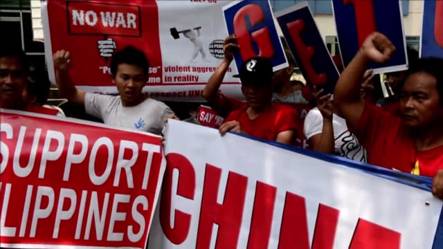 Several hundred Filipino and Vietnamese protesters unite in a march in the Philippine capital demanding that China stop oil drilling in disputed...