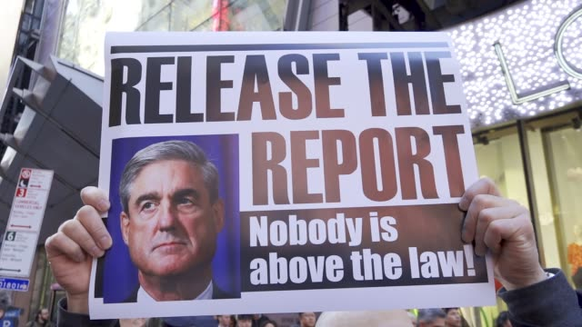 several hundred gathered at 42nd street times square for the 'release the mueller report' rally and march via broadway in the borough of manhattan... - generalstaatsanwalt stock-videos und b-roll-filmmaterial