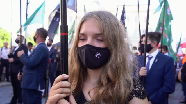 several hundred members and supporters of the ultranationalist, far-right all polish youth march through warsaw, poland on august 15, 2020 on the... - youth organisation stock videos & royalty-free footage