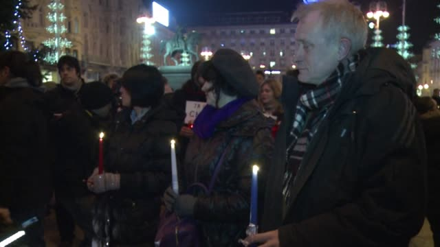 several hundred people, including croatian journalists, gathered on zagrebs central square and walked towards the french embassy to light candles in... - satira video stock e b–roll