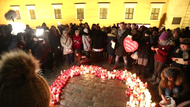 several hundred people light candles in warsaw poland on january 16 2018 for the recent murder of pawel adamowicz the mayor of gdansk who died after... - mayor stock videos & royalty-free footage