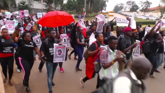 several hundred people march in kampala as they demand action on recent kidnappings and murders targeting women in uganda - kampala stock videos & royalty-free footage