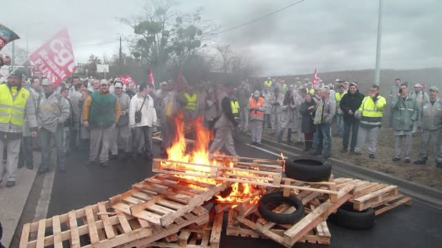 Several hundred Renault employees have protested the auto companys restructuring plan by burning debris on the way to a Renault factory in Flins...