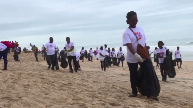 several hundred volunteers mark international coastal cleanup day by cleaning the beach in the ivorian resort of grand bassam - coastal feature stock videos & royalty-free footage