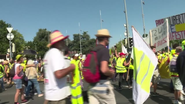 several hundred yellow vest protesters march quietly between the french border and the palais des nations the united nations headquarters in geneva... - yellow stock videos & royalty-free footage