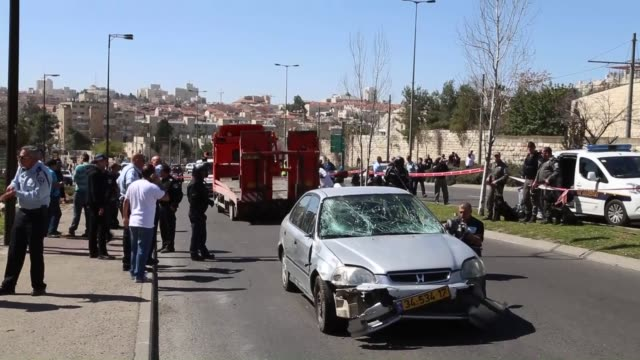 several israelis including four policewomen were injured after a palestinian drove a vehicle into a crowd of israelis at shimon hatzadik trolley... - east jerusalem stock videos and b-roll footage