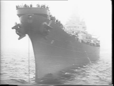 several large battleships float in the hudson river / adjacent to the hudson the west side highway is jammed with cars / montage of crowds on the... - uss missouri stock videos and b-roll footage