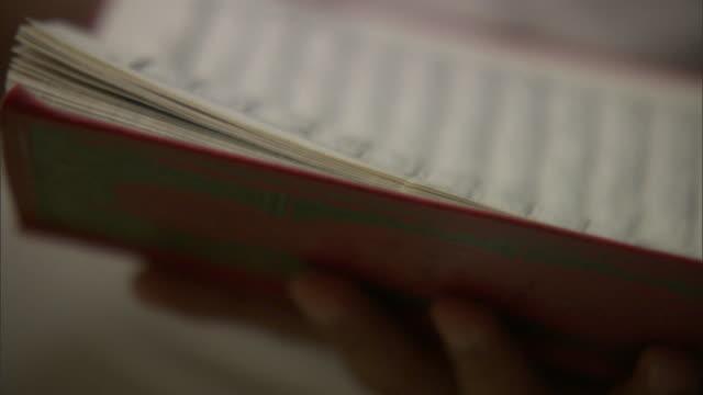 vídeos y material grabado en eventos de stock de several men read from books they hold in their laps. - torah