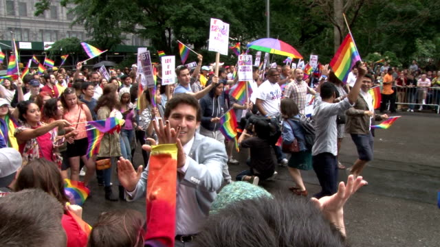 stockvideo's en b-roll-footage met several million people come together at the annual gay pride parade in new york city to celebrate the recent supreme court decision making same sex... - juridisch systeem