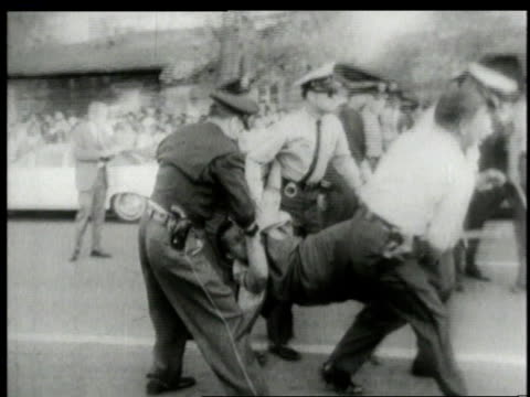 several police officers carrying away a segregation protester / alabama united states - jim crow laws stock videos & royalty-free footage