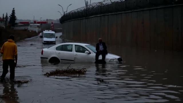 stockvideo's en b-roll-footage met several roads were flooded in jerusalem on tuesday following heavy rainfall including in the arab east jerusalem of beit hanina - oost jeruzalem