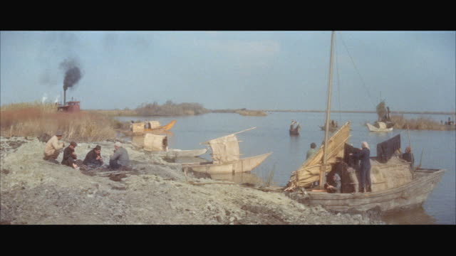 ws several sampans and group of men at river bank  / hong kong  - sampan stock videos & royalty-free footage