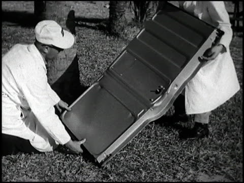 several sheet metal parts on 1963 chevrolet and ford trucks are put through some unusual torture tests doors are crumpled coconuts are dropped on... - chevrolet truck stock videos & royalty-free footage