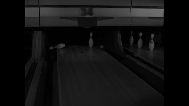 several shots of bowling balls striking pins - ボーリング場点の映像素材/bロール