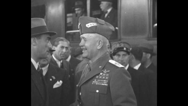 several shots of italian marshal pietro badoglio at a train station; a man hangs out of train window shaking hands; the marshal chats with a... - incomplete stock videos & royalty-free footage