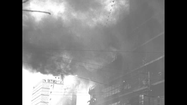 several shots of shirokiya department store on fire and firefighters spraying water on it / firefighters climb ladder to upper story / large group of... - fire escape stock videos and b-roll footage