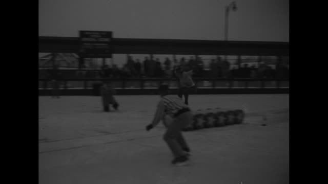 several shots of skaters jumping barrels in ice rink at grossinger's resort in barrel jumping championships with one shot of crowd watching one shot... - jump shot stock videos and b-roll footage
