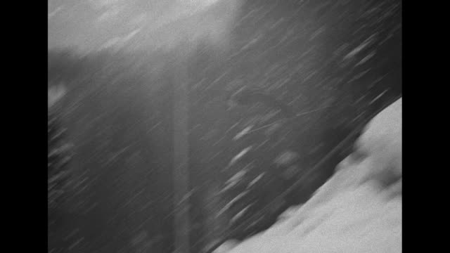 several shots of skijumpers flying in the air / people grooming downhill slope's snow / boy runs past camera with men at chute throwing out snow /... - ski flying stock videos and b-roll footage