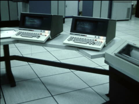 / several shots of univac mainframe computer and men working inside communication centre of 'centre de renseignements policiers du québec' / cu of... - mainframe stock videos & royalty-free footage