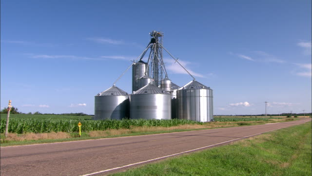 several silos surround a central tower. - granary stock videos & royalty-free footage