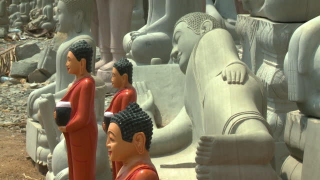 several stone buddha statues in san tok, cambodia - effigy stock videos & royalty-free footage