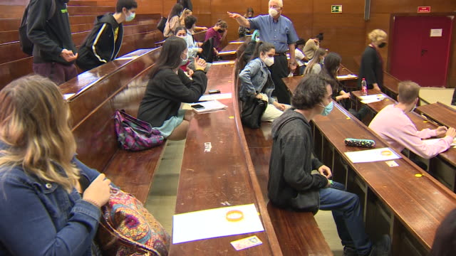 several students wait to start the evau exams in the examination room of the universidad complutense law school, ciudad universitaria. between today... - university student stock videos & royalty-free footage