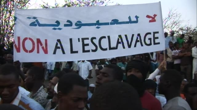 several thousand descendants of black moors who were taken as slaves in mauritania demonstrate in nouakchott to protest against ongoing... - nouakchott stock videos & royalty-free footage