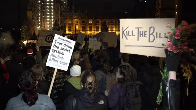several thousand people defy covid regulations and rally on parliament square before marching across westminster bridge and on to new scotland yard... - westminster bridge stock videos & royalty-free footage