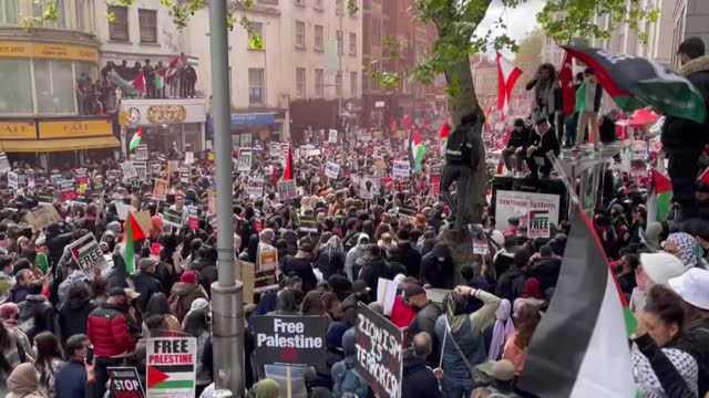 several thousand people on saturday took to the streets of london to support palestinians following a flare-up of israeli-palestinian violence. the... - aggression stock videos & royalty-free footage