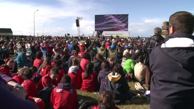 several thousand scouts celebrate 70 years of peace in europe at omaha beach one of the allied landing beaches in frances northern region of normandy... - omaha beach stock videos and b-roll footage